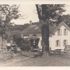 Farmhouse with old cars 1938